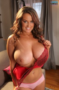 Gorgeous Sarah Randall shows off her luscious melons