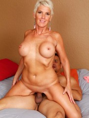 Sexy Lexy Cougar riding a hard cock at karupsow.com