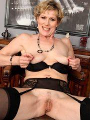 Horny newcomer Georgina C puts on a strip show that includes her favorite dildo at allover30.com
