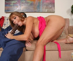 Darla Crane sucks big black cock in front of her son