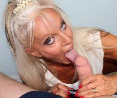 MILF porn star Sally D'Angelo licks a big candy stick at seemomsuck.com
