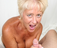 Tracy Licks works over a hard cock until it explodes on her pretty face at seemomsuck.com