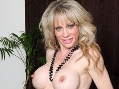 Raquel Sultra gets men horny with her sexy body and big tits at anilos.com